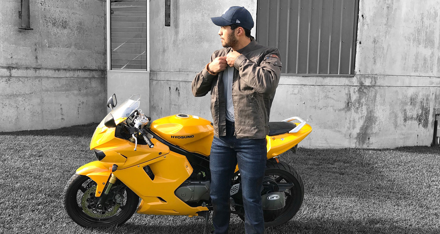 Alex Tarrant with Honda GB400TT cafe racer - wearing Pekev® Lite jeans and Rocker jacket